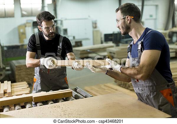 Young men working in lumber workshop - csp43468201