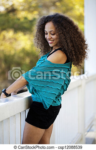 Young Mixed Black Woman Blue Top Outdoors - csp12088539