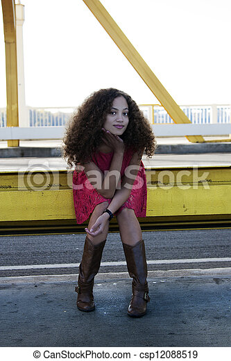 Young Mixed Black Woman Red Dress Sitting - csp12088519