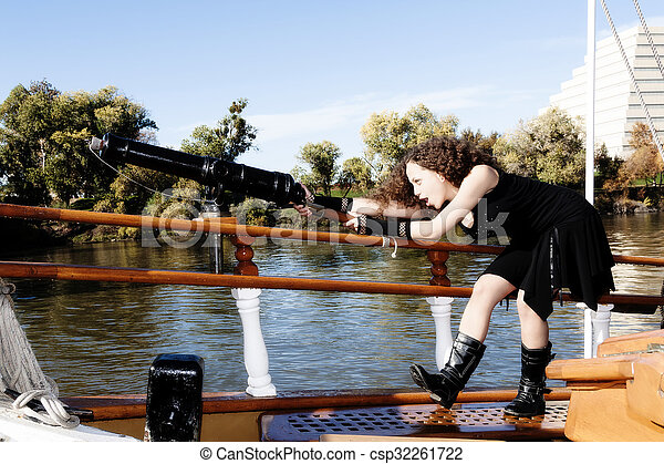 Young Mixed Heritage Woman Aiming Small Cannon - csp32261722