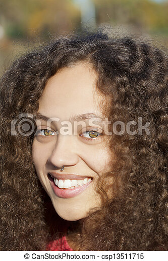 Young Mixed Woman Smiling Outdoors Portrait Piercing - csp13511715