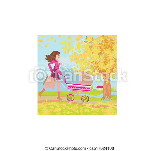 Young mom taking her baby for a stroll through park in autumn - csp17624108