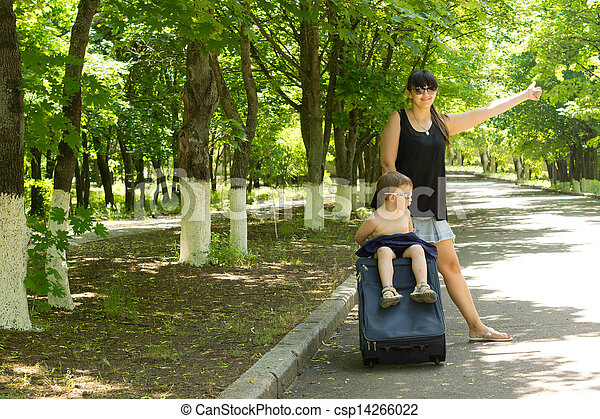 Young mother asking for a lift by the roadside - csp14266022