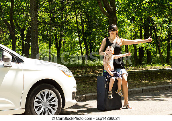 Young mother asking for a lift by the roadside - csp14266024
