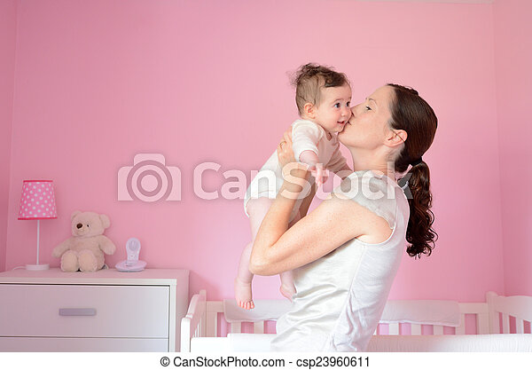 Young mother kisses her baby - csp23960611