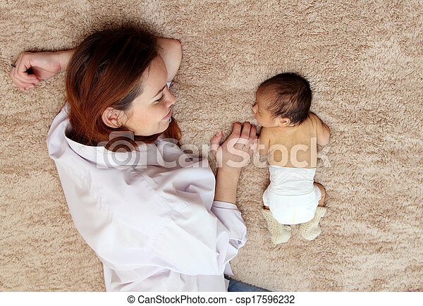 young mother with her newborn baby - csp17596232