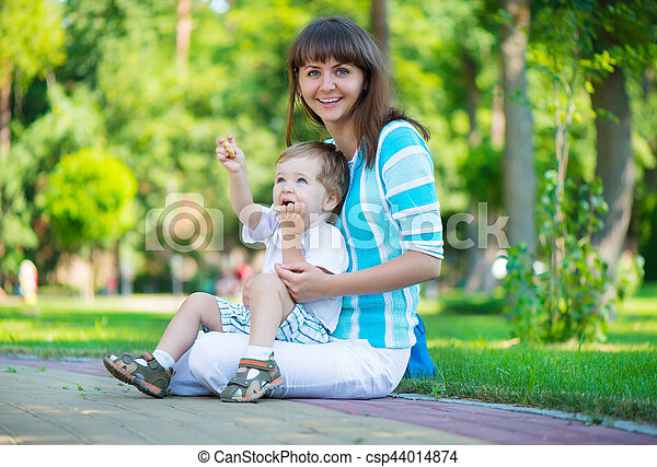 Young mother with her son in park - csp44014874