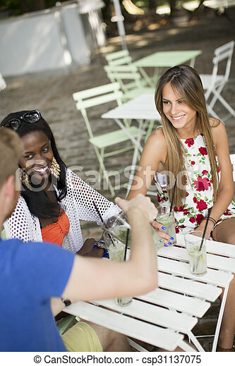 Young multiracial friends at cafe - csp31137075