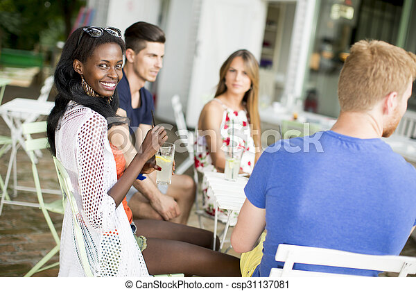 Young multiracial friends at cafe - csp31137081