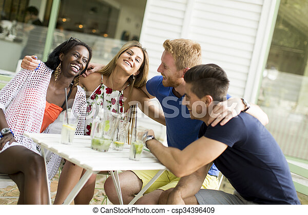 Young multiracial friends at cafe - csp34396409