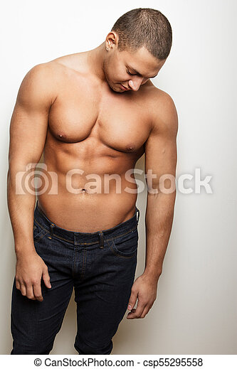 e23021e5 Young muscular guy in blue jeans. Shirtless male in blue jeans ...