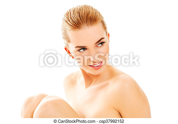 Young nude woman sitting on the floor - csp37992152