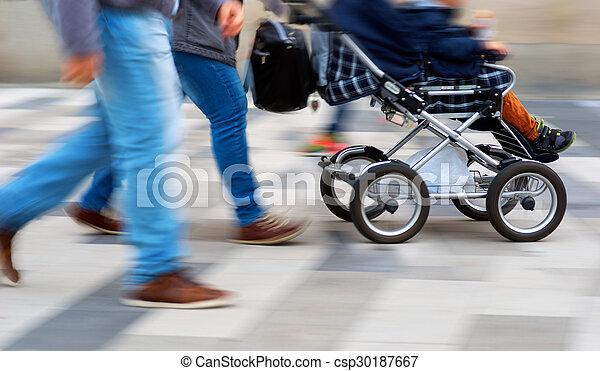 Young parents with pram - csp30187667