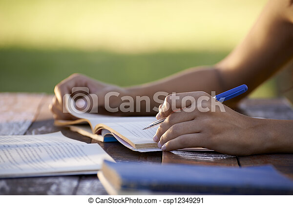 Young people and education, woman studying for university test - csp12349291