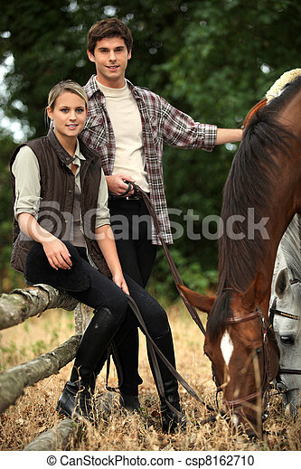 Young people and horses - csp8162710