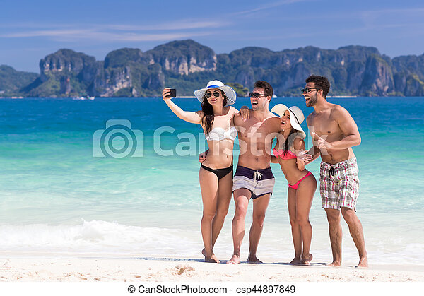 Young People Group On Beach Summer Vacation Two Couple Happy Smiling Friends Taking Selfie Photo