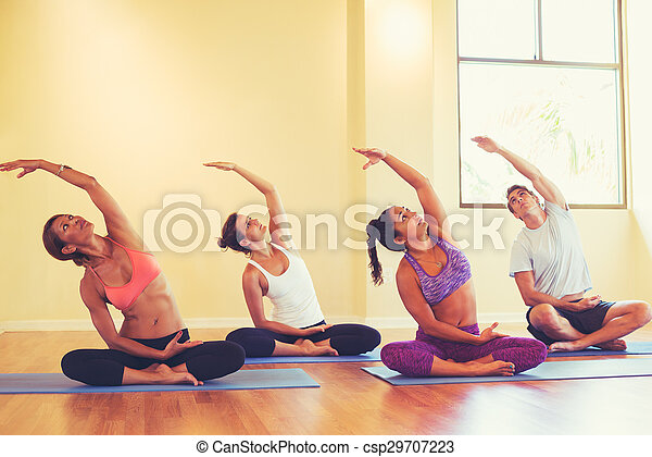 young people stretching in yoga class group of people