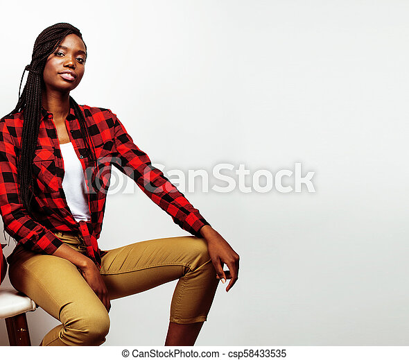 young pretty african-american woman posing cheerful emotional on - csp58433535