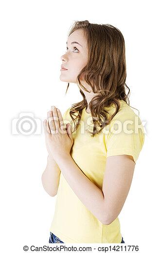 Young pretty caucasian woman praying - csp14211776