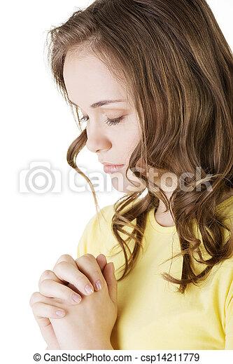 Young pretty caucasian woman praying - csp14211779