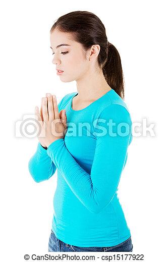 Young pretty caucasian woman praying - csp15177922