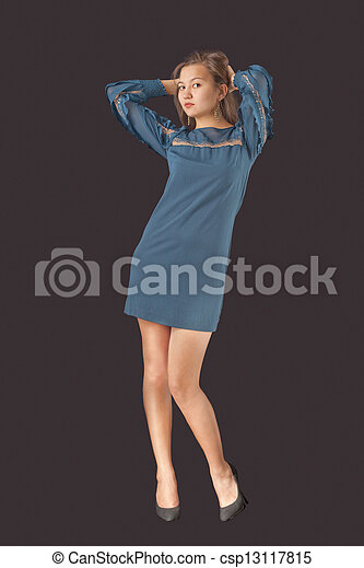 Young pretty woman in cocktail dress - csp13117815