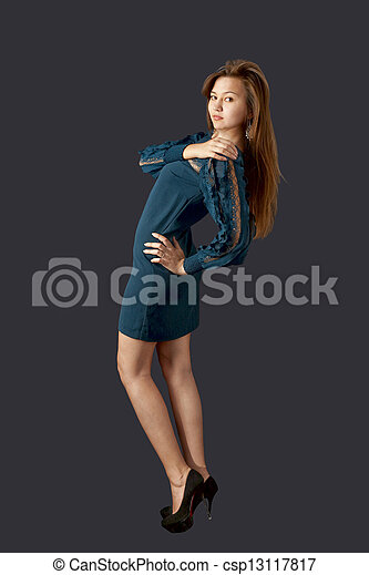 Young pretty woman in cocktail dress - csp13117817