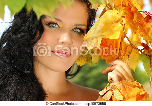 Young pretty woman in the autumn park. - csp10573556