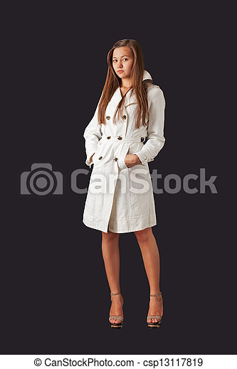 Young pretty woman in white raincoat - csp13117819