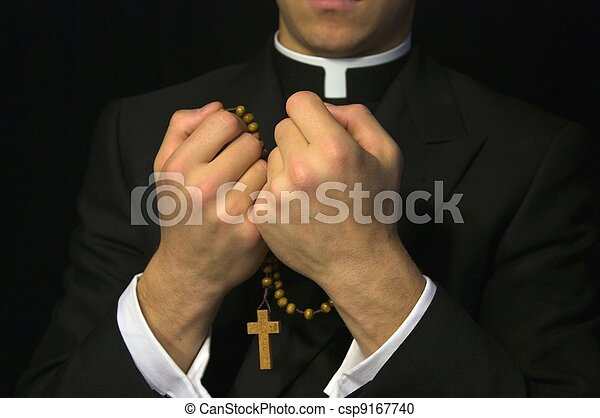 Young Priest praying the Rosary - csp9167740