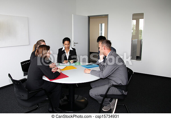 Young Professional Team In A Business Meeting   Csp15734931