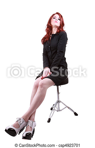 Young red headed woman on stool business dress - csp4923701