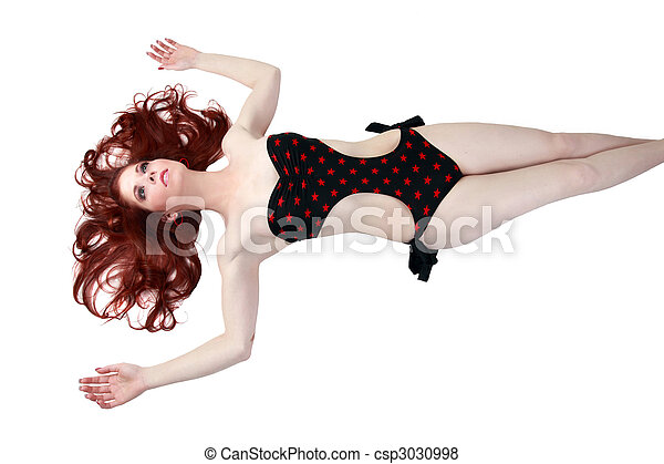 Young redhead woman in bathing suit reclining - csp3030998