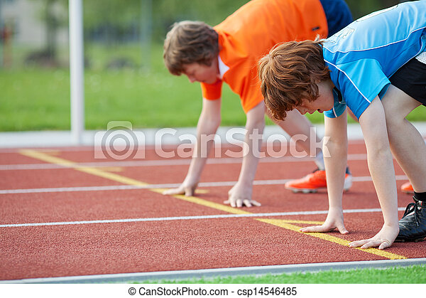 Young Runners On Starting Position At Racetrack - csp14546485
