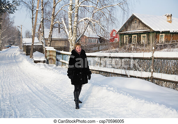 Young russian woman in the village at winter. - csp70596005
