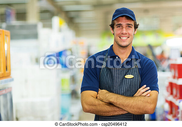 young salesman standing in hardware store - csp20496412