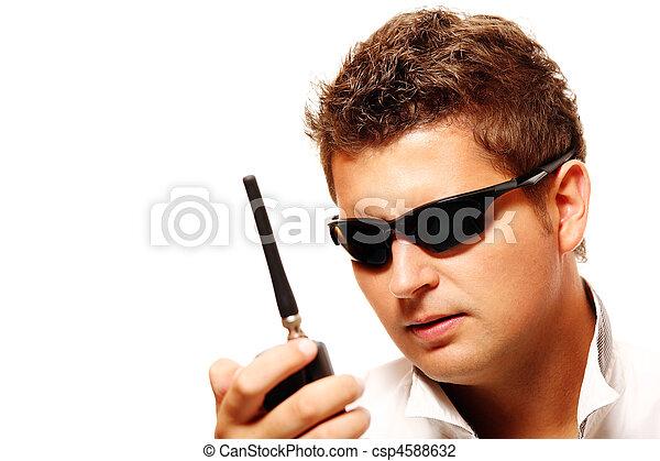 Young security man with radio transmitter - csp4588632