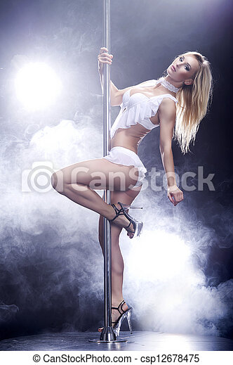 Young sexy pole dance woman. - csp12678475