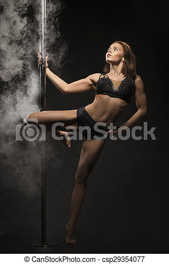Young sexy pole dance woman. - csp29354077