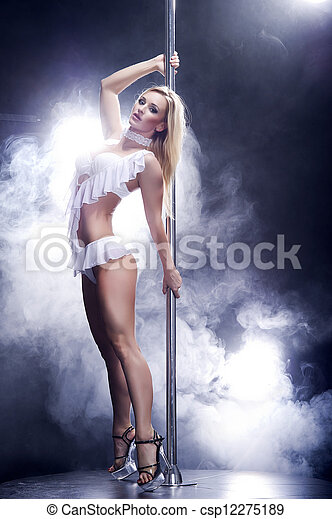 Young sexy pole dance woman. - csp12275189