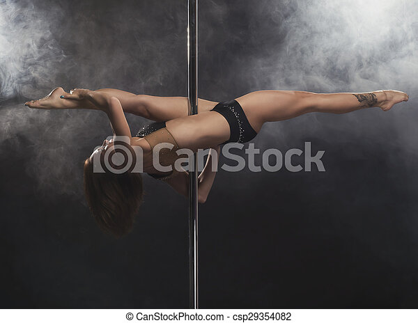 Young sexy pole dance woman. - csp29354082