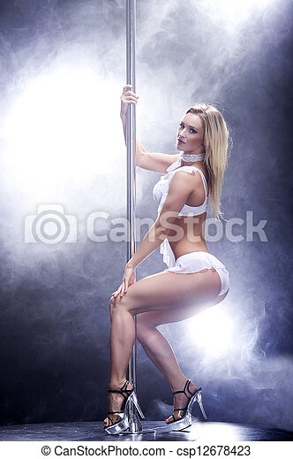 Young sexy pole dance woman. - csp12678423