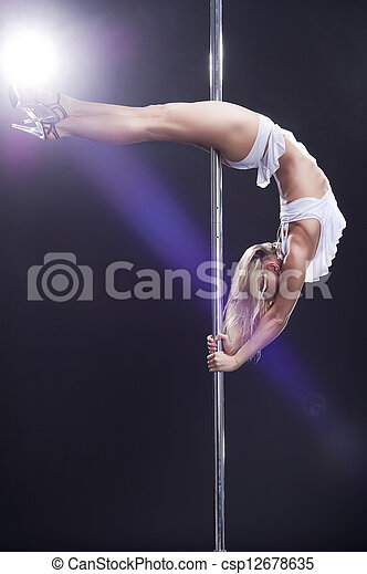Young sexy pole dance woman. - csp12678635