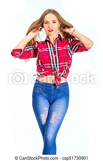 17677cf6d57 Young sexy woman dressed in jeans and checkered shirt posing in studio -  csp51730901