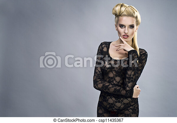Young sexy woman on wall background portrait. - csp11435367