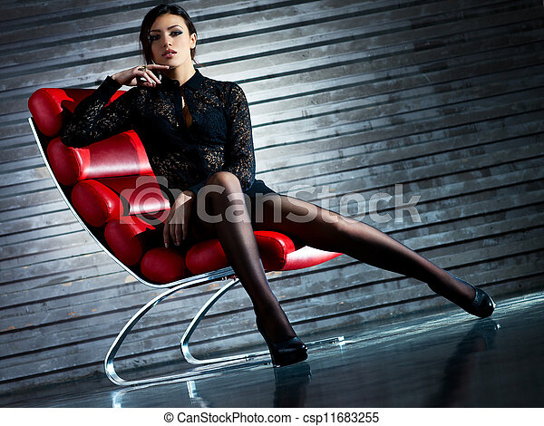 Young sexy woman sitting on chair - csp11683255