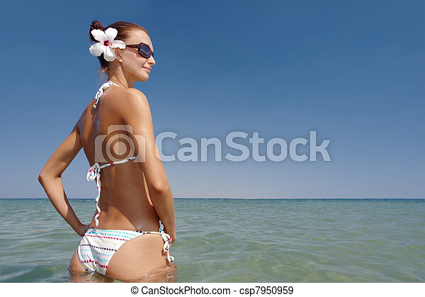 young sexy woman sunbathing - csp7950959