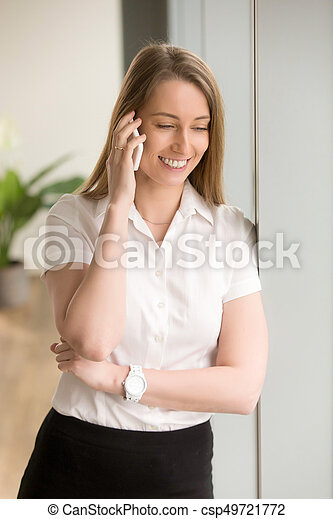 Young smiling businesswoman talking on phone, mobile communicati - csp49721772