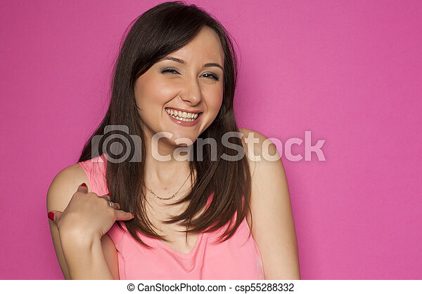 Young smiling woman on pink background - csp55288332