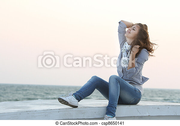 young smiling woman on sea background - csp8650141